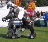 You guessed it, a huge robot riding on the back of a motorised wheelchair.