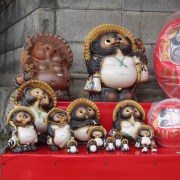 Statues of tanuki (raccoon dogs), notable for their huge testicles.