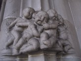 Architectural sculpture of evil babies.